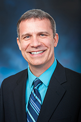 Photo of a Wil Pineau, the Chamber CEO smiling.
