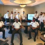 Photo of The RCIPS Community Policing Unit and Security Officers at National Security Services Limited.
