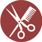 Icon of scissors and a comb.